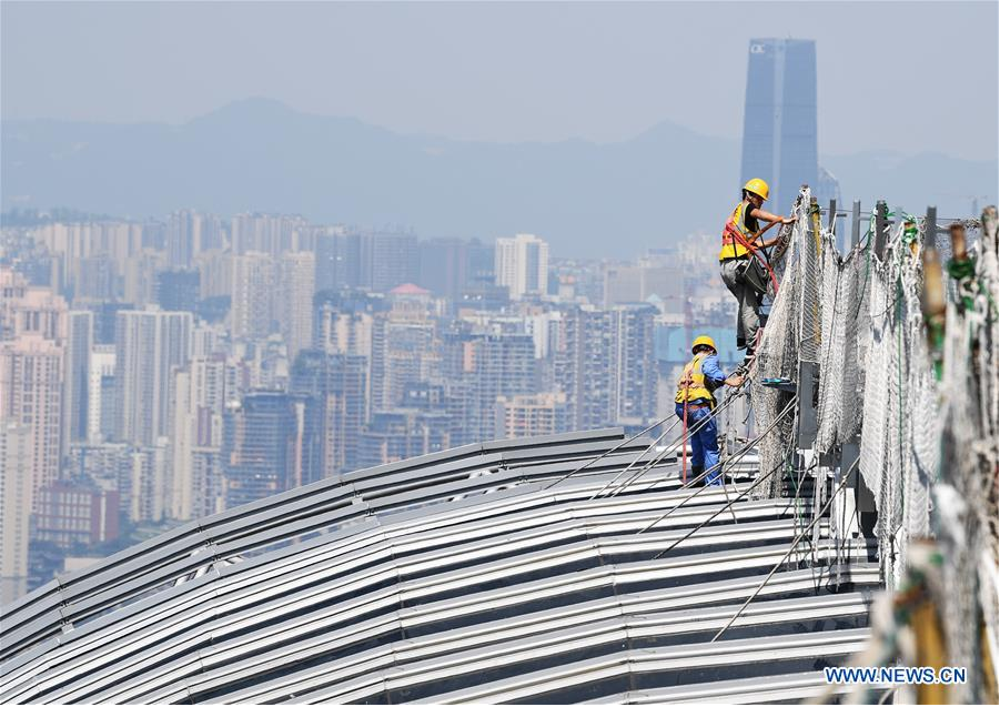 People work in heatwave in China's Chongqing